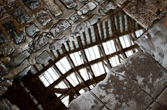 Reflection of Ceiling in Puddle at Leadenhall Market