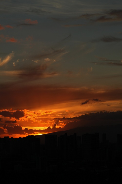 Sun Setting Over Honolulu Hawaii