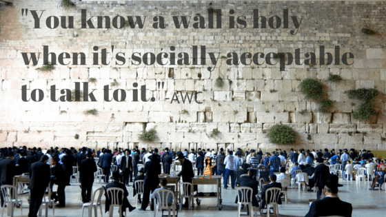 People praying to a shrubby wall- (3)
