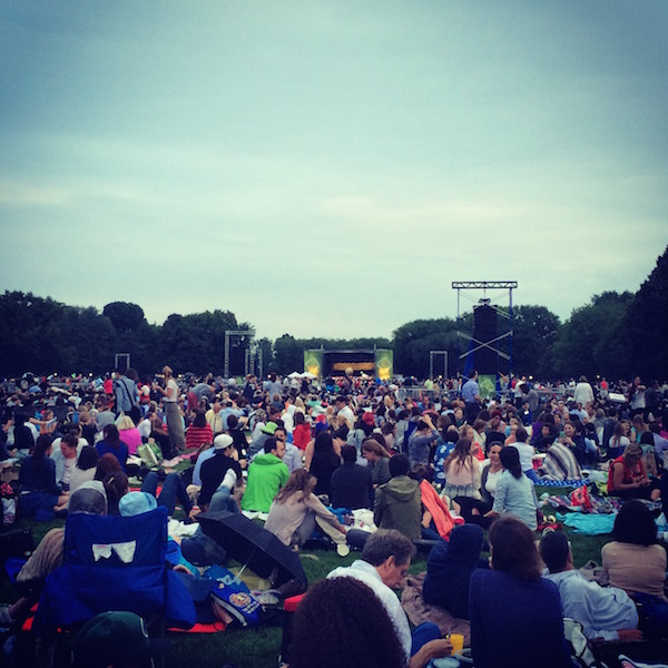 The New York Philharmonic in Central Park. Can you see the stage? Because I can't.