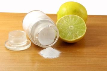 baking soda or baking powder in glass bottle with lemon fruit