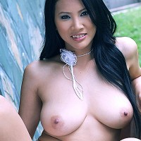 Busty Thai babe Nancy Ho strips