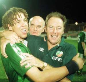 Liam George, complete with dreadlocks, celebrates with Kerr.