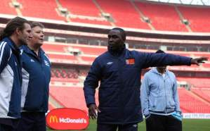 Cole directs the traffic, during a McDonald's Coaching Masterclass, at Wembley.