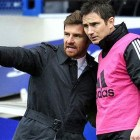 A telling lack of eye contact, wholly mutual respect and mutual communication: Villas-Boas hands Lampard instructions as the final Chelsea substitute against Birmingham City on 83' on 17 February, 2012