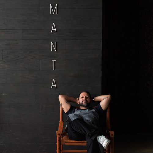 Chef Enrique Olvera in front of his restaurant, Manta