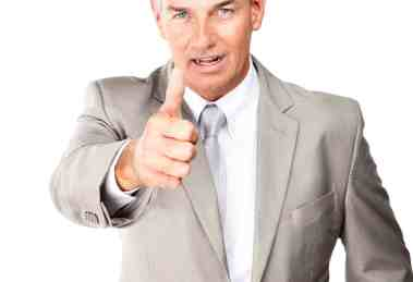 Image of a mature confident business man showing thumbs up