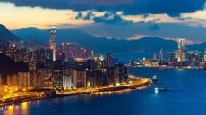 Hong_Kong_world_architecture_cities_buildings_skyscrapers_night_lights_hdr_window_signs_neon_shore_sound_bay_water_vehicles_ships_skyline_cityscape_mountains_sky_clouds_sunset_sunrise_scenic_1920x1080