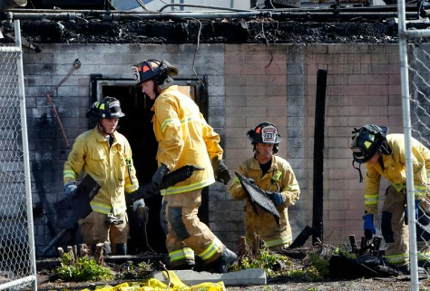 Santa Clara County firefighters begin their investigation into the cause of an early morning fire at Manresa restaurant in Los Gatos, Calif., Monday morning July 7, 2014. (Karl Mondon/Bay Area News Group)