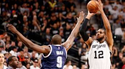 Apr 30, 2016; San Antonio, TX, USA; San Antonio Spurs power forward LaMarcus Aldridge (12) shoots the ball over Oklahoma City Thunder power forward Serge Ibaka (9) in game one of the second round of the NBA Playoffs at AT&T Center. Mandatory Credit: Soobum Im-USA TODAY Sports