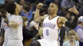 Oklahoma City Thunder's Cameron Payne, left, and teammate Russell Westbrook, right and their pre-game dance ritual before the first half of an NBA basketball game against the Charlotte Hornets in Charlotte, N.C., Saturday, Jan. 2, 2016. The Thunder won 109-90. (AP Photo/Bob Leverone) ORG XMIT: OTKBL101