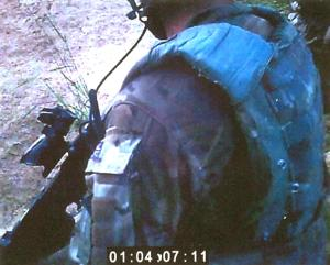 Footage captured by a camera mounted on a helmet during a patrol in Afghanistan in Sept. 2011, showed a British Royal Marine shooting a man in the chest. A Harvard professor is arguing that Marines and other troops can stop bad behavior by speaking up.  (AP Photo/ Ministry of Defense)
