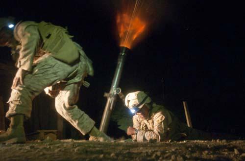 Marines firing illumination rounds in Kajaki, Afghanistan