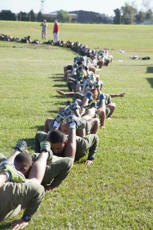 Marines and sailors who performed a 138-person chain push-up broke the Guinness World Record, the organization annouced last week.  (Lance Cpl. Justin Rodriguez/Marine Corps)