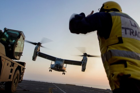 An MV-22B Osprey assigned to Marine Medium Tiltrotor Squadron (VMM) 226 (Reinforced), 26th Marine Expeditionary Unit (MEU), takes off from the flight deck of the HMS Illustrious (R06), at sea, Sept. 16, 2013. The 26th MEU is a Marine Air-Ground Task Force forward-deployed to the U.S. 5th and 6th Fleet areas of responsibility aboard the Kearsarge Amphibious Ready Group serving as a sea-based, expeditionary crisis response force capable of conducting amphibious operations across the full range of military operations. (U.S. Marine Corps photograph by  (Cpl. Kyle N. Runnels/Marine Corps)