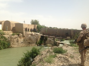 A Marine stands by the Helmand River at FOB Sabit Qadam as Afghan and Marine officials tour the base.​