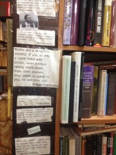 The ends of the shelves were decorated with bookish quotations