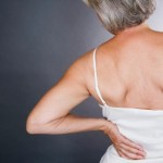 A senior woman with backache --- Image by © I Love Images/Corbis
