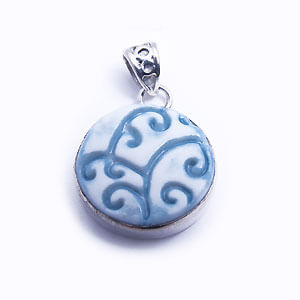 Riccioli - a round hand carved porcelain pendant set in sterling silver. Available in light blue, blue, red and grey.