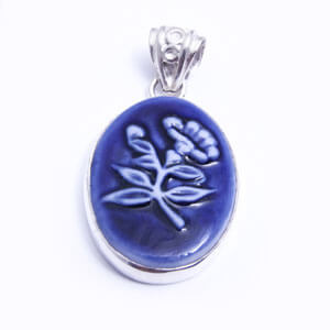A porcelain and sterling silver pendant designed by Belen Berganza