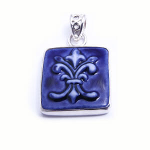 Flordelis is a hand carved rectangular porcelain pendant glazed and set in sterling silver. Available in blue, light blue, red and grey.
