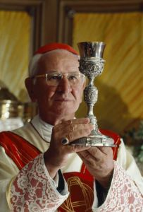 A Catholic bishop holds a platinum chalice made in Spain in 1788.