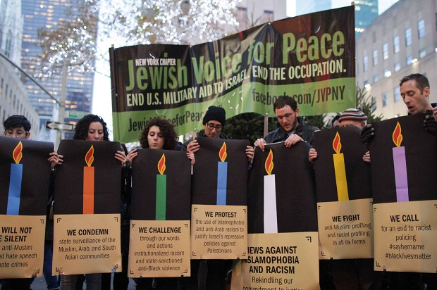 """We will not be silent"": American Jews hit the streets during Hanukkah to fight Islamophobia and racism"