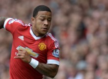 Manchester United's Dutch midfielder Memphis Depay runs with the ball during the English Premier League football match between Manchester United and Newcastle United at Old Trafford in Manchester, north west England, on August 22, 2015. AFP PHOTO / OLI SCARFF  RESTRICTED TO EDITORIAL USE. No use with unauthorized audio, video, data, fixture lists, club/league logos or 'live' services. Online in-match use limited to 75 images, no video emulation. No use in betting, games or single club/league/player publications.