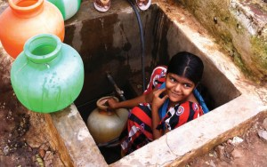 Residents of Hubli-Dharwad fill storage containers to ensure they have continuous access to water in the face of an intermittent supply water system. Because water pressure in the pipes is often so low, the faucet is located below ground level, and frequently floods during the rainy season. Credit: Kara Nelson