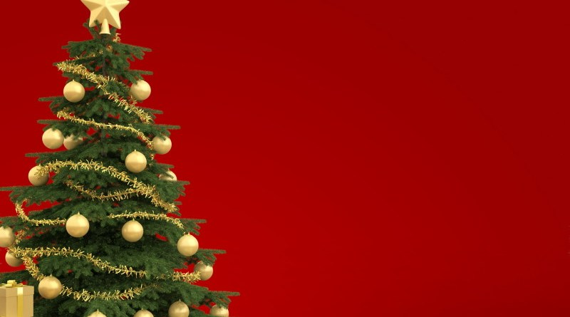 Golden decorated christmas tree with many presents isolated against a red background
