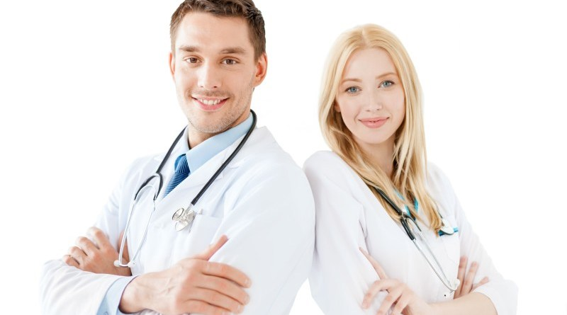 healthcare and medical concept - smiling young male doctor and female nurse with stethoscope in hospital