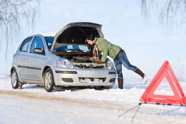 8641983-Winter-car-breakdown-woman-try-to-repair-motor-Stock-Photo-snow. Picture courtesy 123rf.comjpg