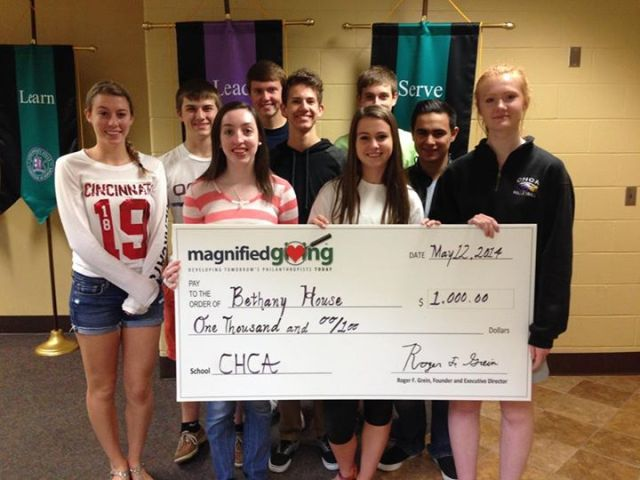 Magnigied Giving check