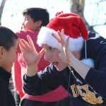 Senior Jordan Hop plays peek-a-boo with a startled first grader.