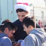 Senior Johnny Perez exchanges his Instagram with thrilled students from Albion Street.