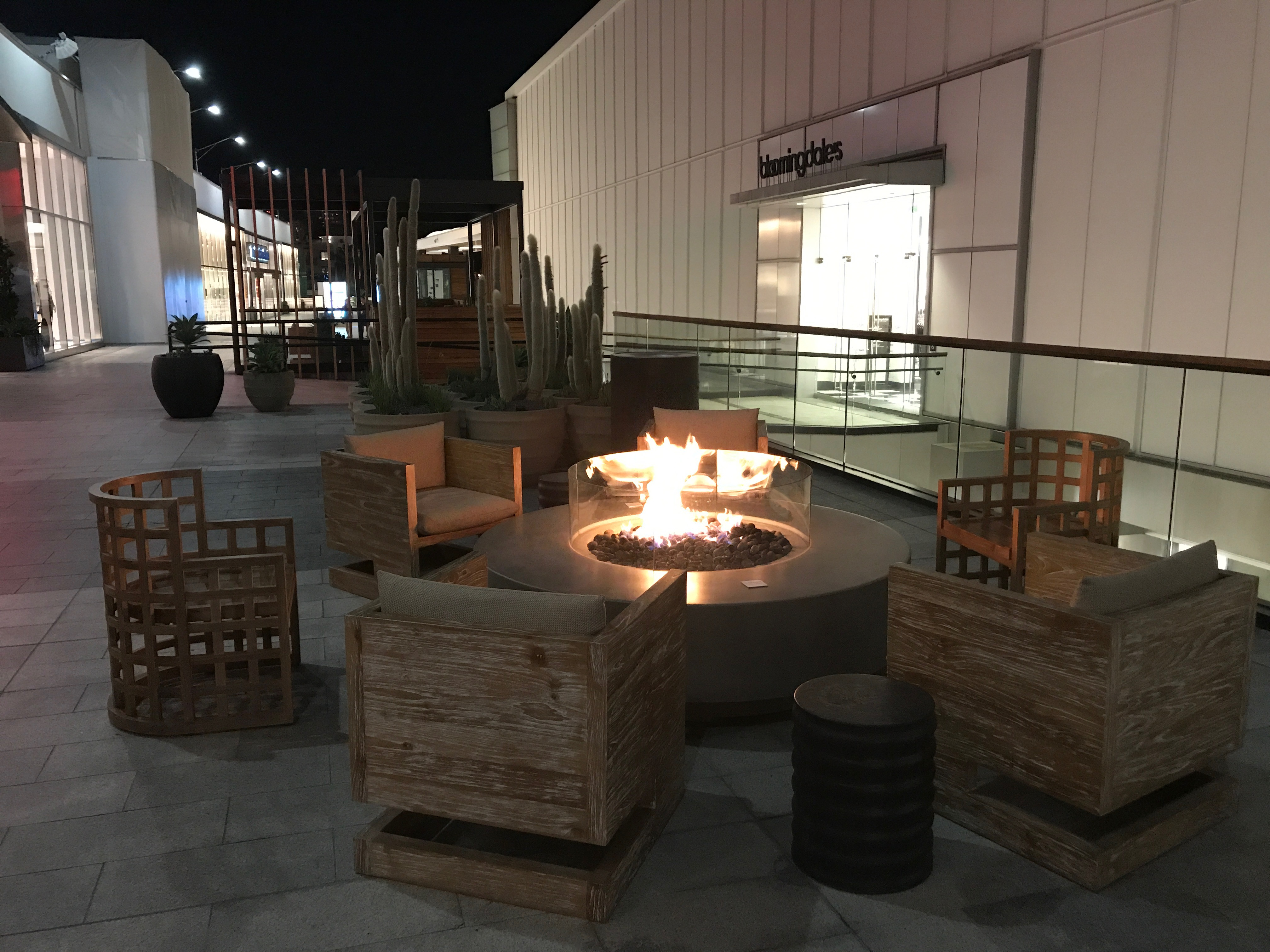 Lounging areas including a fire pit are scattered throughout the mall.