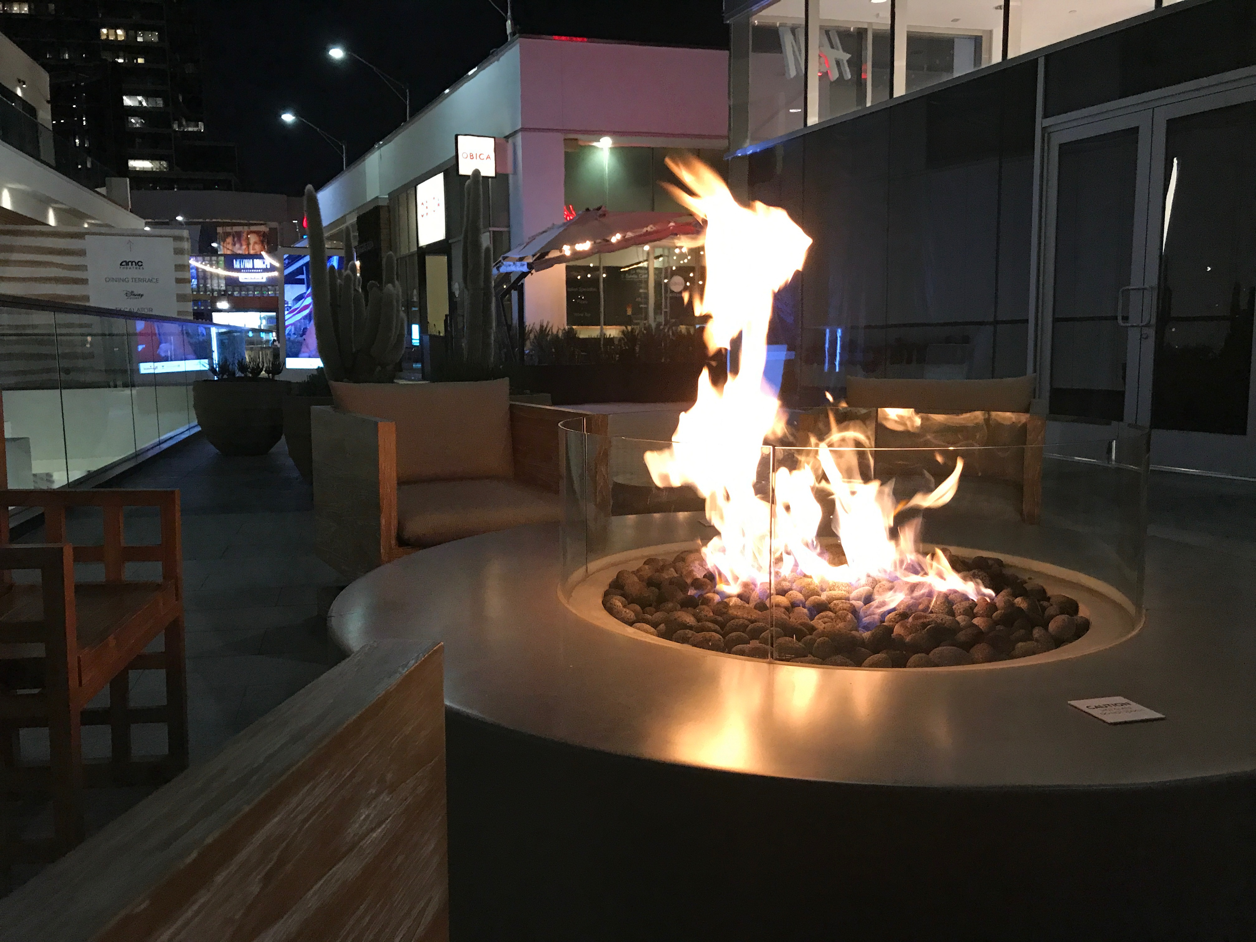 The fire pits in the lounging areas are lit every day at sundown.