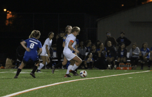 Dani Elitzur dodges defenders and brings the ball down the field. Photo by: Priscilla Hopper