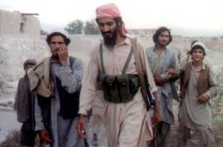 This file photo taken in 1989 shows Osama bin Laden (centre) walking with Afghanis in the Jalalabad area.