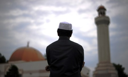 A Muslim takes part in a special morning prayer to start Eid-al-Fitr festival, marking the end of their holy fasting month of Ramadan, at a mosque in Silver Spring, Maryland, on August 19, 2012. Muslims in the US joined millions of others around the world to celebrate Eid-al-Fitr to mark the end of Ramadan with traditional day-long family festivities and feasting. AFP PHOTO/Jewel SAMAD        (Photo credit should read JEWEL SAMAD/AFP/GettyImages)