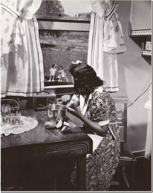1942 Anacostia Mother watching her kids while preparing dinner, Wash DC - Gordon Parks