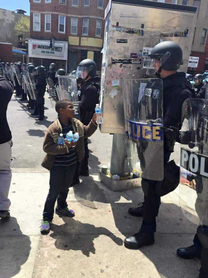 Boy Offering Water To Police Goes Viral