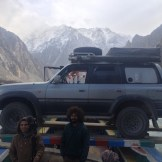 Boris takes his first dingy ride (Attabad Lake, Pakistan)