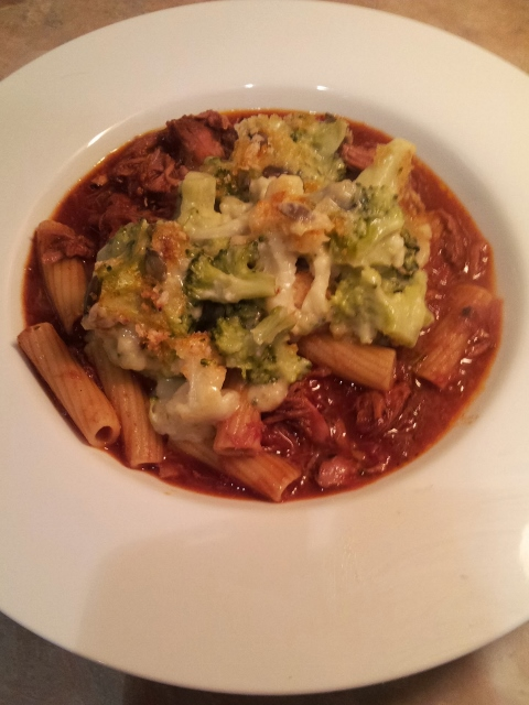 pork and lamb ragu topped with broccoli cheese