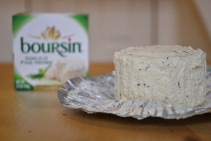 Creamy Boursin cheese is melted in butter for parmesan popcorn. Full recipe on BigTasteTinySpace.com