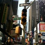 A bike path with its own traffic signal passes through Times Square.