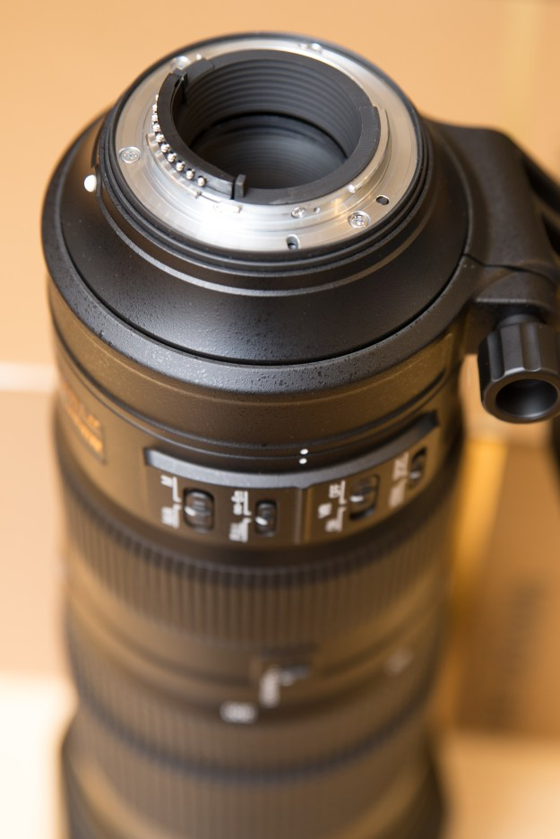 This photo shows the Nikon F-mount flange on the 200-500 f/5.6E lens. Notice the rubber gasket which provides a seal between the lens and camera body for protection from weather and the elements. The lens also features a rubberized ring at the front of the lens, also for weather sealing. (Bill Ferris)