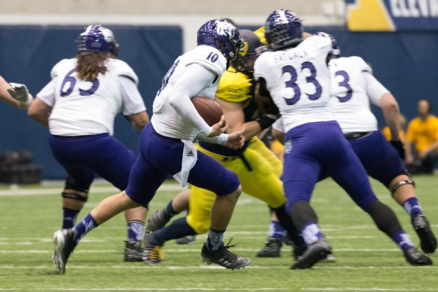 A Weber State running back sprints to the right during a game against Northern Arizona in the J. L. Walkup Skydome. This photo was taken with the Nikon D610 and 200-500mm f/5.6E at 400mm, f/5.6, ISO 6400, 1/200-second. It has been cropped processed to taste in Adobe Lightroom. (Bill Ferris)