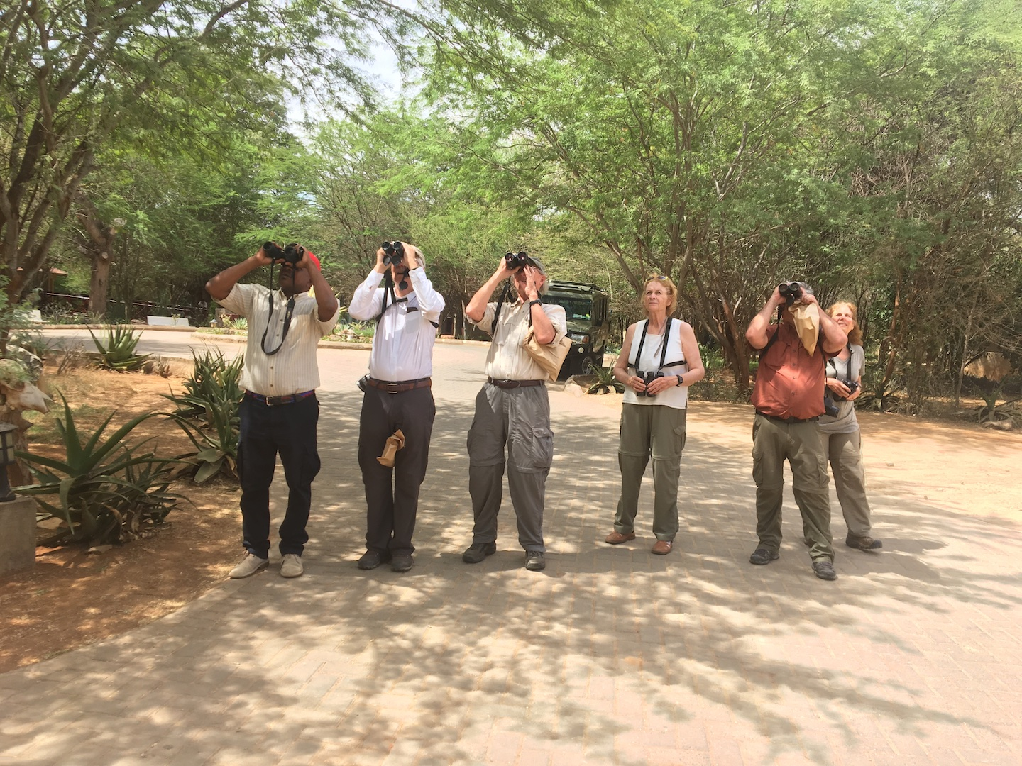 L-R: Driver Maxwell, Denis, Nicholas, Carolyn, Mitch and Sonny from USA at Aruba Camp, Tsavo East during a 21-day birding trip in February 2019