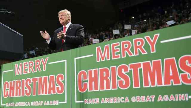 """FILE - In this Dec. 8, 2017, file photo, President Donald Trump takes to the stage at a campaign-style rally at the Pensacola Bay Center, in Pensacola, Fla. There's no mistaking Trump's """"Merry Christmas"""" message _ he wields it as a weapon against political correctness. For weeks, he's been liberally sprinkling his public remarks with Christmas tidings. (AP Photo/Susan Walsh, File)"""
